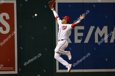 Washington Nationals left fielder Juan Soto misses a double by Los Angeles Dodgers' David Freese during the seventh inning in Game 3 of a baseball National League Division Series, in Washington