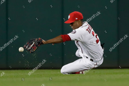Stock Photo of Washington Nationals center fielder Michael A. Taylor misses a ball hit by Los Angeles Dodgers' Corey Seager for a single during the eighth inning in Game 3 of a baseball National League Division Series, in Washington
