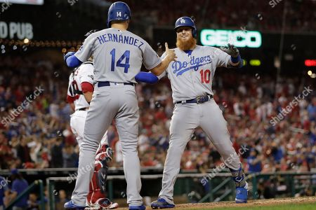 Los Angeles Dodgers third baseman Justin Turner (10) celebrates his three-run home run off Washington Nationals relief pitcher Wander Suero with Enrique Hernandez (14) during the sixth inning in Game 3 of a baseball National League Division Series, in Washington