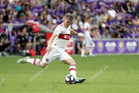 Chicago Fire midfielder Bastian Schweinsteiger moves the ball against Orlando City during the first half of an MLS soccer match, in Orlando, Fla