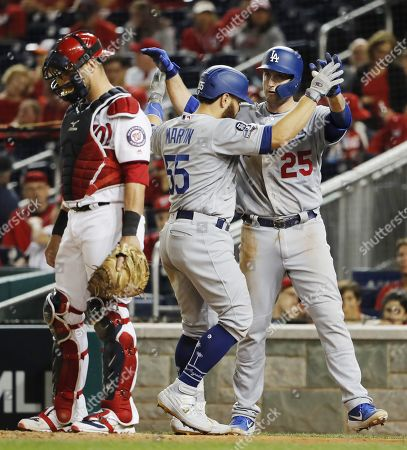 Stock Photo of Los Angeles Dodgers batter Russell Martin (C) celebrates with teammate David Freese (R) after hitting a two-run home run against the Washington Nationals in the top of the ninth inning of their MLB National League Divsion Series playoff baseball game three at Nationals Park in Washington, DC, USA, 06 October 2019. The winner of the five game playoff series will go on to face either the Atlanta Braves or the St. Louis Cardinals in the National League Championship Series.