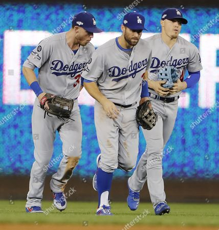 Stock Photo of Los Angeles Dodgers (L-R) Cody Bellinger, Chris Taylor and Enrique Hernandez celebrate after defeating  the Washington Nationals in their MLB National League Divsion Series playoff baseball game three at Nationals Park in Washington, DC, USA, 06 October 2019. The winner of the five game playoff series will go on to face either the Atlanta Braves or the St. Louis Cardinals in the National League Championship Series.