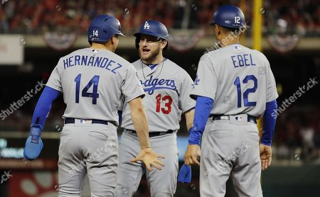 Los Angeles Dodgers batter Enrique Hernandez (L) celebrates with teammate Max Mundy (C) after hitting a two-run double against the Washington Nationals in the top of the sixth inning of their MLB National League Divsion Series playoff baseball game three at Nationals Park in Washington, DC, USA, 06 October 2019. The winner of the five game playoff series will go on to face either the Atlanta Braves or the St. Louis Cardinals in the National League Championship Series.