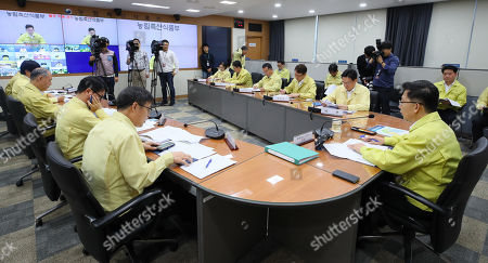Stock Photo of South Korea's Agriculture Minister Kim Hyun-soo (R) presides over a daily meeting on African Swine Fever (ASF), in Sejong, South Korea, 07 October 2019. South Korea has confirmed 13 African Swine Fever (ASF) cases since 17 September 2019.