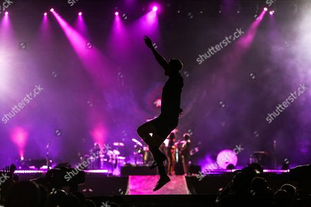 Stock Photo of Dan Reynolds performs on stage with his band Imagine Dragons during the last day of Rock in Rio 2019 music festival in Rio de Janeiro, Brazil, 06 October 2019.