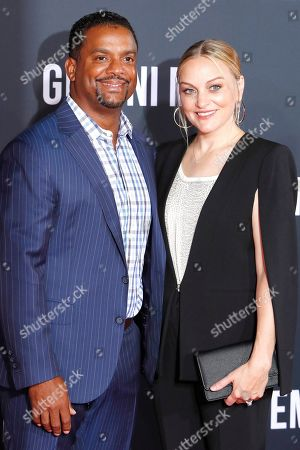 Stock Photo of Alfonso Ribeiro (L) and his wife Angela Unkrich (R) pose on the red carpet as they arrive at the premiere of Gemini Man at the TCL Chinese Theatre IMAX in Los Angeles, USA, 06 October 2019. The movie opens in US theaters on 11 October 2019.
