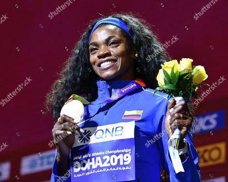 Stock Image of Caterine Ibarguen (COL) - Women's Triple Jump Medal ceremony at Khalifa International Stadium in Doha, Qatar.
