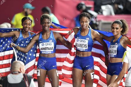 Dalilah Muhammad (L), Wadeline Jonathas, Phyllis Francis and Sydney McLaughlin of the United States celebrate winning the women's 4x400m relay final