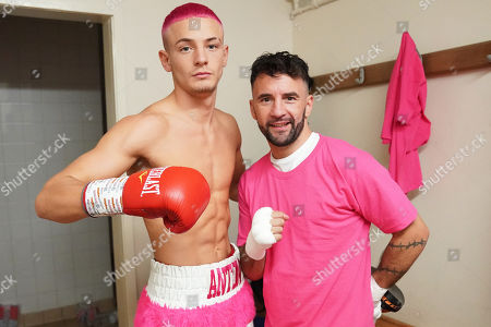 Stock Picture of Anton Haskins (L) and father Lee Haskins pose for a photograph in the dressing room during a Boxing Show at Whitchurch Leisure Centre on 5th October 2019. Lee Haskins and his son Anton Haskins both appeared on the same card, Anton making his professional debut.
