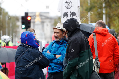 Mark Rylance, center, a British actor who won an Oscar for Best Supporting Actor, takes part in a climate demonstration in central London . Activists with the Extinction Rebellion movement blocked major roads in London, Berlin and Amsterdam on Monday at the beginning of what was billed as a wide-ranging series of protests demanding new climate policies