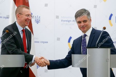 Latvian Foreign Minister Edgars Rinkevics, left, shakes hands with Ukrainian Foreign Minister Vadym Prystaiko after their joint news conference following the talks in Kyiv, Ukraine