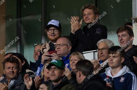CAPTION CORRECTION: Singer Ed Sheeran at Portman Road celebrates the own goal by Bradley Garmston of Gillingham, 3-0