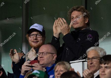 \Ed Sheeran celebrates the third Ipswich Town goal, an own goal by Bradley Garmston of Gillingham, 3-0