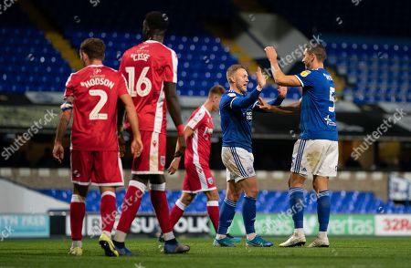 Danny Rowe of Ipswich Town celebrates the own goal by Bradley Garmston of Gillingham  with James Wilson of Ipswich Town, 3-0