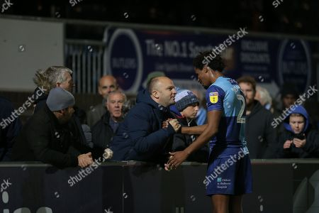 Sido Jombati of Wycombe Wanderers with fans after the match