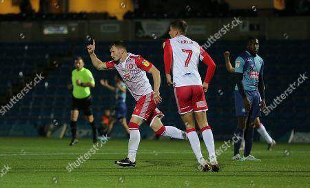 Jason Cowley of Stevenage celebrates scoring the opening goal