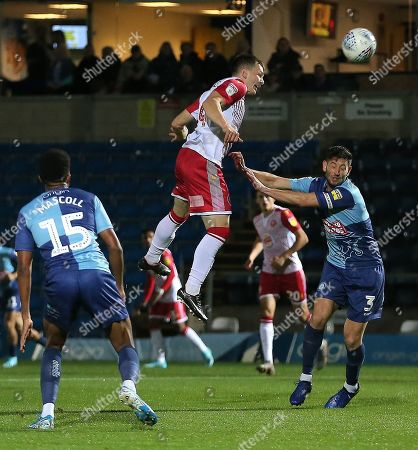 Jason Cowley of Stevenage scores the opening goal