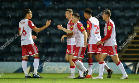 Jason Cowley of Stevenage celebrates scoring the opening goal with team-mates