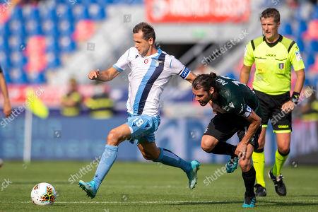 Andrea Poli (Bologna) Senad Lulic (Lazio)