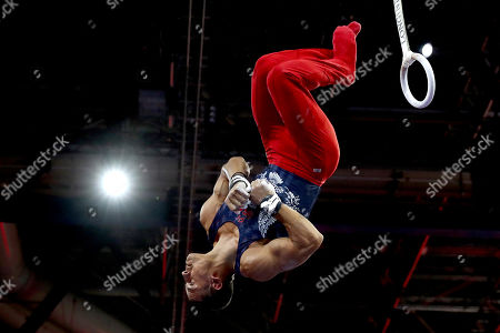 Stock Image of Trevor Howard of the U.S. performs on the rings during men's qualifying sessions for the Gymnastics World Championships in Stuttgart, Germany
