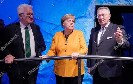 German Chancellor Angela Merkel (C), Baden-Wuerttemberg's Prime Minister Winfried Kretschmann (L) and Alfred Ehrhard (R), chairman of the board of Climate Arena Dietmar Hopp Foundation, stand during the opening Ceremony of the Climate Arena Dietmar Hopp Foundation in Sinsheim, Germany, 07 October 2019. The non-profit Climate Foundation for Citizens (Klimastiftung für Buerger) is engaged with the Klima Arena for a better understanding of climate, environment, renewable energies and the protection of resources to enable future generations a sustainable future.