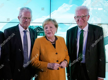 German Chancellor Angela Merkel (C), Dietmar Hopp (L), Founder of the Dietmar Hopp Foundation, and Baden-Wuerttemberg's Prime Minister Winfried Kretschmann (R) stand during the opening Ceremony of the Climate Arena Dietmar Hopp Foundation in Sinsheim, Germany, 07 October 2019. The non-profit Climate Foundation for Citizens (Klimastiftung für Buerger) is engaged with the Klima Arena for a better understanding of climate, environment, renewable energies and the protection of resources to enable future generations a sustainable future.