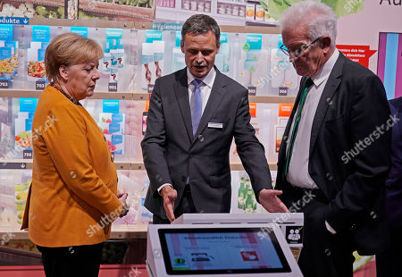 Bernd Welz (C), chairman of the board of Climate Arena Dietmar Hopp Foundation, is explain German Chancellor Angela Merkel (L) and Baden-Wuerttemberg's Prime Minister Winfried Kretschmann (R) how do you can climate-friendly shopping, during the opening of the Climate Arena Dietmar Hopp Foundation in Sinsheim, Germany, 07 October 2019. The non-profit Climate Foundation for Citizens (Klimastiftung für Buerger) is engaged with the Klima Arena for a better understanding of climate, environment, renewable energies and the protection of resources to enable future generations a sustainable future.