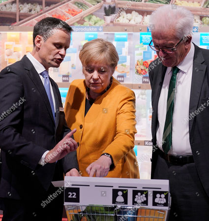 Bernd Welz (L), chairman of the board of Climate Arena Dietmar Hopp Foundation, is explain German Chancellor Angela Merkel (C) and Baden-Wuerttemberg's Prime Minister Winfried Kretschmann (R) how do you can climate-friendly shopping, during the opening of the Climate Arena Dietmar Hopp Foundation in Sinsheim, Germany, 07 October 2019. The non-profit Climate Foundation for Citizens (Klimastiftung für Buerger) is engaged with the Klima Arena for a better understanding of climate, environment, renewable energies and the protection of resources to enable future generations a sustainable future.