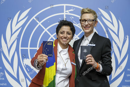 Australian actress and UNHCR goodwill ambassador Cate Blanchett, right, and Maha Mamo, left, former stateless refugee, show their passeports during a press conference after speaking at a High-Level Segment on Statelessness to the 70th annual meeting of the UNHCR Executive Committee, at the European headquarters of the United Nations in Geneva, Switzerland, 07 October 2019.