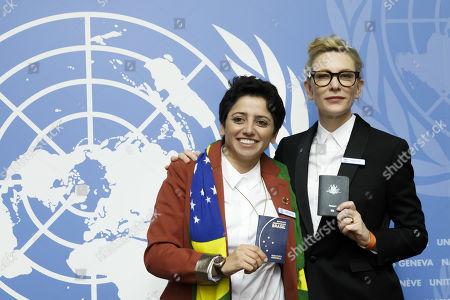 Australian actress and UNHCR goodwill ambassador Cate Blanchett, right, and Maha Mamo, left, former stateless refugee, show their passports during a press conference after speaking at a High-Level Segment on Statelessness to the 70th annual meeting of the UNHCR Executive Committee, at the European headquarters of the United Nations in Geneva, Switzerland, 07 October 2019.
