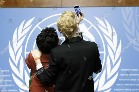 Maha Mamo, left, former stateless refugee, makes a selfie with Australian actress and UNHCR goodwill ambassador Cate Blanchett, right, with holding their passports during a press conference after speaking at a High-Level Segment on Statelessness to the 70th annual meeting of the UNHCR Executive Committee, at the European headquarters of the United Nations in Geneva, Switzerland, 07 October 2019.