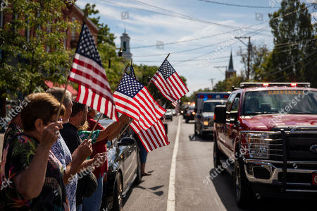 A memorial procession for Sgt. James Johnston, who was killed in Afghanistan in June, passes through Trumansburg, N.Y., . Two months after his death, his adopted hometown had come together over a holiday weekend to pay tribute, and to say goodbye