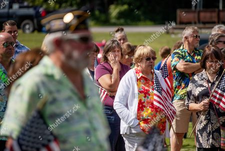 Members of the public attend a memorial service, in Trumansburg, N.Y., for Sgt. James Johnston, who was killed in Afghanistan in June. Hundreds of people, some wearing Hawaiian shirts and plastic leis in Johnston's honor, lined a pathway next to bricks etched with the names of local boys who'd gone to war, some never to return. The gathering was a combination barbecue, fundraiser and day of remembrance