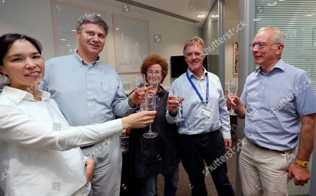 Scientist Peter J.Ratcliffe, second from right, celebrates with his team at the University in Oxford, England, . Two Americans and a British scientist won the 2019 Nobel Prize for Physiology or Medicine for discovering how the body's cells sense and react to oxygen levels, work that has paved the way for new strategies to fight anemia, cancer and other diseases Drs. William G. Kaelin Jr. of Harvard University, Gregg L. Semenza of Johns Hopkins University and Peter J. Ratcliffe at the Francis Crick Institute in Britain and Oxford University will share the 9 million kronor ($918,000) cash award