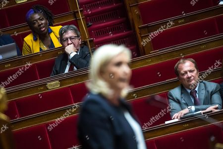 French president of La France Insoumise (France Unbowed) party, Jean-Luc Melenchon (2-L) listens to the President of far-right Rassemblement National (RN) Marine Le Pen speaking during a debate on migration at the National Assembly in Paris, France, 07 October 2019.