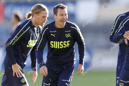 Switzerland's national soccer team player Michael Lang (L) and Stephan Lichtsteiner (R) during a training session before the upcoming UEFA Euro 2020 qualifying soccer matchs, at the Stade Olympique de la Pontaise in Lausanne, Switzerland, 07 October 2019. Denmark will play Switzerland for the UEFA Euro 2020 qualifying Group D soccer match on October 12 in Copenhagen.