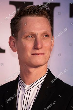 Tom Harper poses for photographers upon arrival at the premiere of the film 'The Aeronauts' which is screened as part of the London Film Festival, in central London