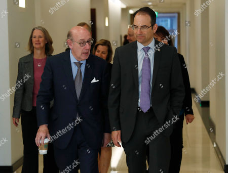 Stock Image of Kenneth Feinberg, Phil Weiser, r m. Kenneth Feinberg, left, who is leading a program to compensate people who were abused by Catholic priests in Colorado, chats with Colorado Attorney General Phil Weiser as members of the investigative committee follow them into a news conference to announce that the program is now open for the submission of claims, in Denver. Administrators said that they were sending out packets to 65 people who previously reported abuse to the church to ask if they would like to submit a claim against the three archdioceses--Denver, Colorado Springs and Pueblo