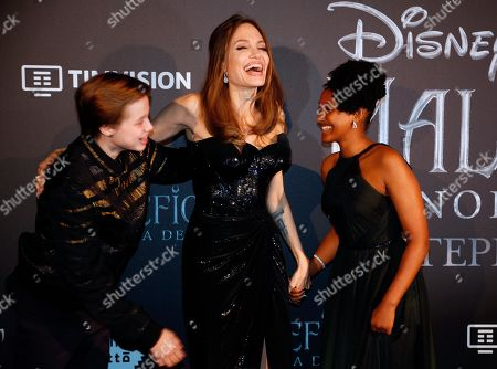Angelina Jolie arrives with her daughter Zahara, right, and son Shiloh Jolie-Pitt, for the European premiere of the film 'Maleficient: mistress of evil', in Rome