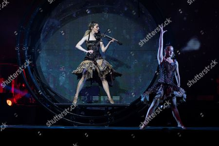 US violinist and singer Lindsey Stirling (L) performs during her concert in Papp Laszlo Sports Arena in Budapest, Hungary, 07 October 2019.