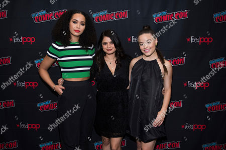 """Madeleine Mantock, Melonie Diaz, Sarah Jeffery. Madeleine Mantock, left, Melonie Diaz and Sarah Jeffery attend New York Comic Con to promote The CW's """"Charmed"""" at the Jacob K. Javits Convention Center, in New York"""