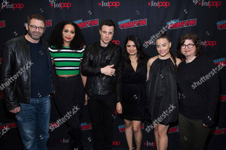"""Craig Shapiro, Madeleine Mantock, Melonie Diaz, Sarah Jeffery, Rupert Evans, Liz Kruger. Craig Shapiro, left, Madeleine Mantock, Rupert Evans, Melonie Diaz, Sarah Jeffery and Liz Kruger attend New York Comic Con to promote The CW's """"Charmed"""" at the Jacob K. Javits Convention Center, in New York"""