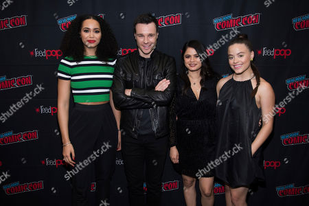 """Madeleine Mantock, Melonie Diaz, Sarah Jeffery, Rupert Evans. Madeleine Mantock, left, Rupert Evans, Melonie Diaz and Sarah Jeffery attend New York Comic Con to promote The CW's """"Charmed"""" at the Jacob K. Javits Convention Center, in New York"""