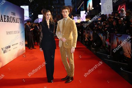 Hannah Bagshawe, Eddie Redmayne. Actor Eddie Redmayne, right, and his wife Hannah Bagshawe pose for photographers upon arrival at the premiere of the film 'The Aeronauts' which is screened as part of the London Film Festival, in central London
