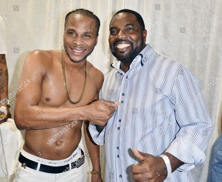 Stock Picture of Reggae Singer Dexta Daps and City of Miramar Commissioner Maxwell B. Chambers backstage