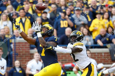 Michigan wide receiver Tarik Black (7) reaches for a pass as Iowa defensive back D.J. Johnson (12) defends during the first half of an NCAA college football game in Ann Arbor, Mich