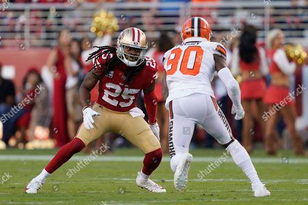 San Francisco 49ers cornerback Richard Sherman (25) defends Cleveland Browns wide receiver Jarvis Landry (80) during an NFL football game in Santa Clara, Calif