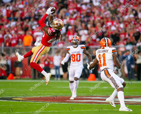 Stock Picture of San Francisco 49ers cornerback Richard Sherman (25) makes an interception during the NFL football game between the Cleveland Browns and the San Francisco 49ers at Levi's Stadium in Santa Clara, CA. The 49ers lead the Browns 21-3 at halftime