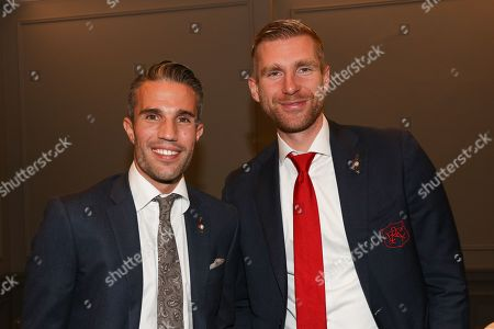 Robin van Persie and Per Mertesacker