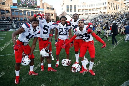 R m. From left, Arizona Wildcats cornerback Christian Roland-Wallace (4), Arizona Wildcats safety Christian Young (5), Arizona Wildcats running back Gary Brightwell (23), Arizona Wildcats cornerback Bobby Wolfe (25) and Arizona Wildcats cornerback Malik Hausman (23) in the second half of an NCAA college football game, in Boulder, Colo. Arizona won 35-30